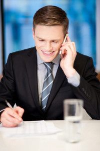 Young businessman communicating over phone call