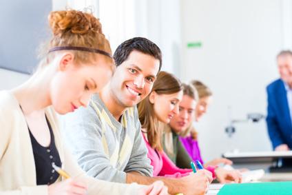 University college students having examination